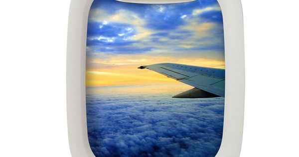 A Picture Frame That Looks Like An Airplane Window Air