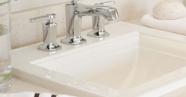 White porcelain sinks from kohler blend with silestone for Silestone kitchen sinks