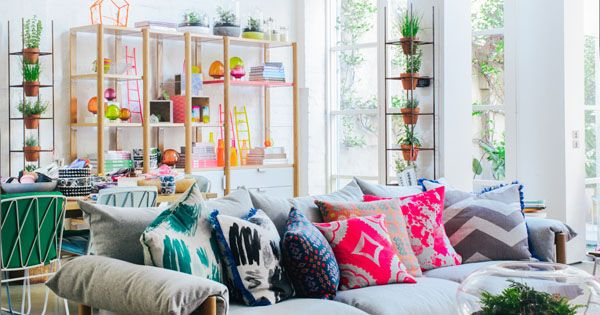 Eclectic pillows. Neutrals. Bright colors. Plants. Light, Bright, Airy Living Space TDFOH
