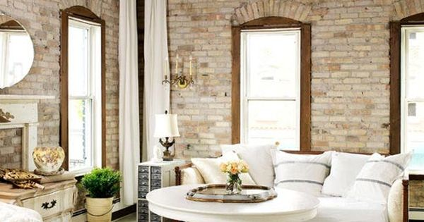 Love this white living room with the exposed brick walls. Home Interiors