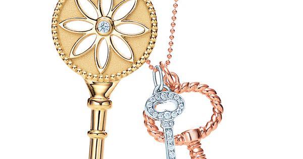 Tiffany Keys, from left: daisy pendant in 18k gold with a diamond,