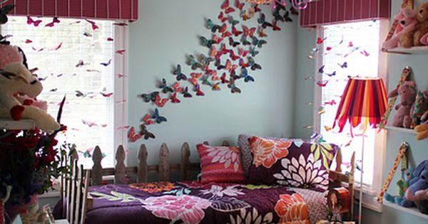 Butterflies and pompoms. Cute idea for the girls room kids bedroom