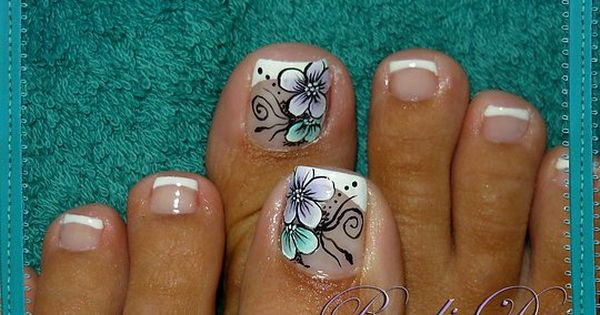 I usually don't like overly decorated toe nails but this ...