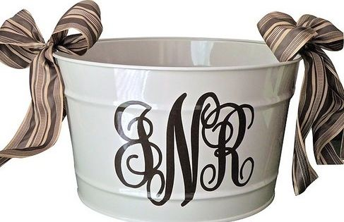 Spray painted galvanized bucket with monogram. Great Wedding or Housewarming gift idea.