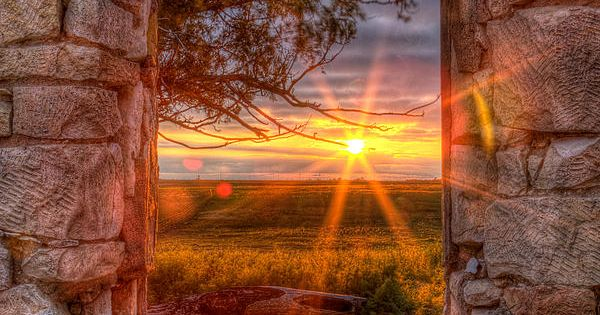 "The photographer describes it this way... ""A Kansas sunset through the window"