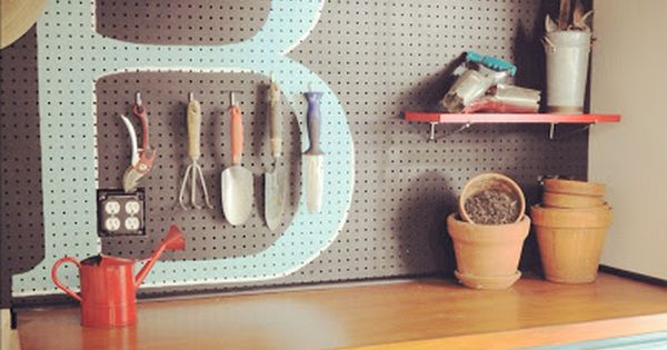 Painted peg board. Craft room, laundry room, mud room or garage organization.