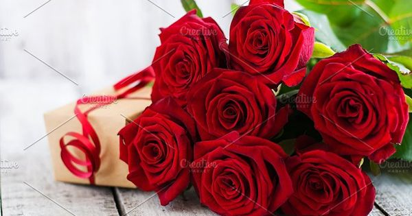 Bouquet of red roses on a light wooden background
