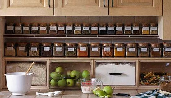 Shelving under kitchen cabinet. pretty spice jars