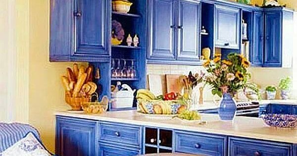 Dramatic blue kitchen cabinets against yellow painted for Blue kitchen cabinets with yellow walls