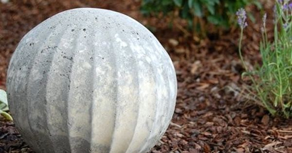 diy project: shannon's concrete garden spheres | Design*Sponge. Old glass, light bulb