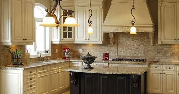 Antique white cabinets light granite antique black for Antique white kitchen cabinets with dark island