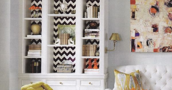 built in with chevron pattern and light above the shelves. yellow upholstery