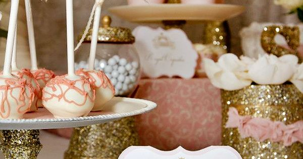 An elegant sweet table in gold and pink - perfect for a
