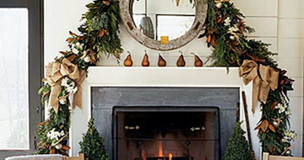 Burlap bows and garland over mirror Christmas mantle