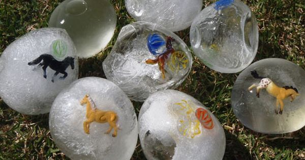 ice eggs - Freeze balloons filled with water and small toys. Cut