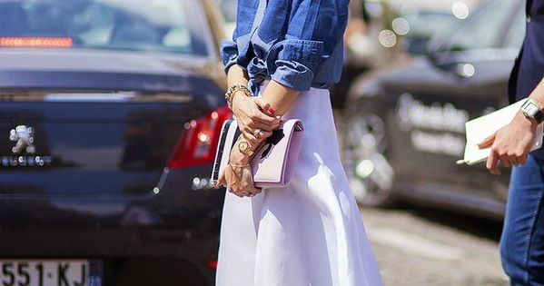 Olivia Palermo looks polished and chic in a white flowy skirt, heels,