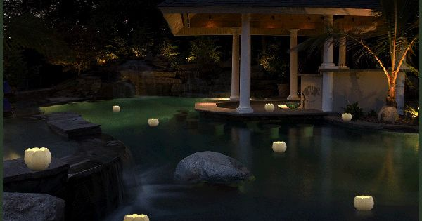 Floating luminary lotus candles are reusable made by for Reusable luminaries