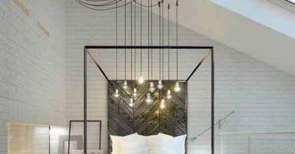 black and white bedroom, multiple lights hung over bed, dark herringbone wood