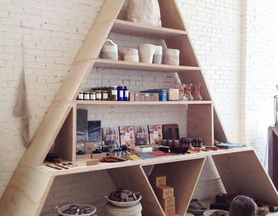 I need to make this! Triangle shelving unit at General Store in