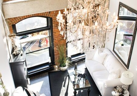 Everything about this is amazing! High ceilings, chandelier, black window frames, exposed