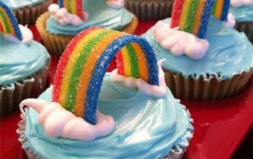 Rainbow Cupcakes- for the one year old's rainbow party. Word to the