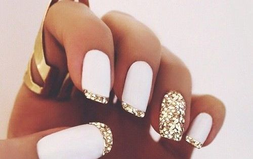 Super stylish nail art! White matte polish & gold glitter french tips