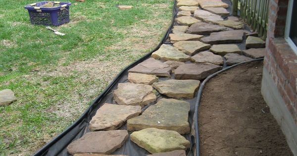 gravel in backyard | Then put down paper to prevent weeds and