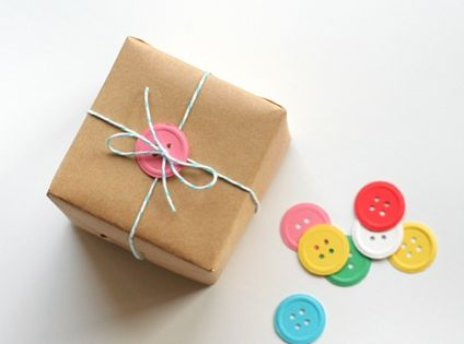 giftwrap. Use Martha Stewart's embossing button punch... or use real buttons!