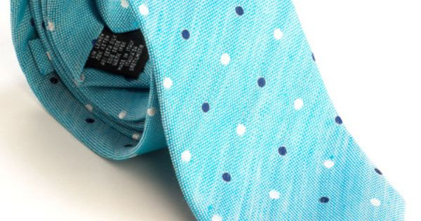 Beautiful linen/silk blend in turquoise with woven white and navy polka dots. Navy blue silk lining. Handwoven and handmade in Como, Italy