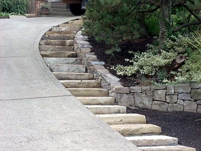 Single Stone Steps By Steep Driveway My Property Is So Badly In Need Of This Solution Driveway Landscaping Steep Gardens Driveway Design