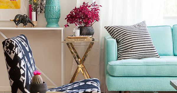 happy living room with gold accents sand a turquoise sofa,
