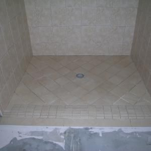 Rollover Curb Shower Form Of A Curbless Shower Best Bathroom Flooring Shower Floor Bathroom Shower Tile