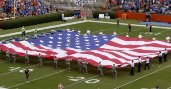 An American Flag Was Held Over Ben Hill Griffin Stadium Saturday Before The Start Of The Game Against Furman University Of Florida Usa Flag God Bless America