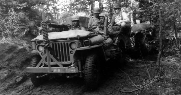 Jeep Of 442nd Regimental Combat Team Crawls Through A Forest Military Vehicles Military Willys