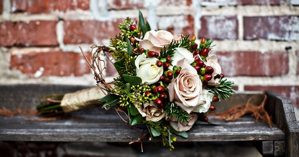 winter wedding bouquet: pale pink roses and red berries