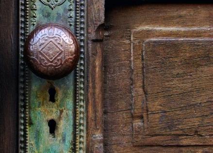 Antique Old Door Knob on vintage wooden door.... Love it... everything from