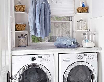 Fabulous laundry room with beadboard ceiling and gray slate tile floors. A