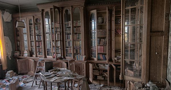 I wonder what these walls remember... I love photos of old abandoned buildings, but they make me sort of sad. And, really? Who could leave all these books, not to mention the beautiful cabinetry! I would love to walk through a few old abandoned houses lik...