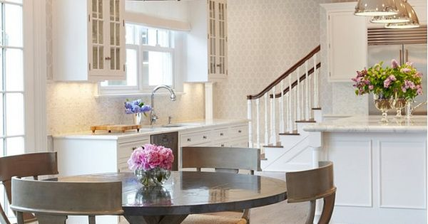 Kitchen & dining room. Rustic round table, elegant chairs, gorgeous chandelier and