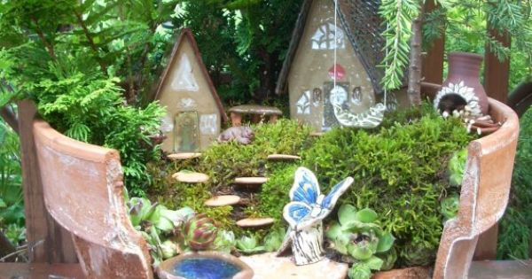 Love the broken clay pot fairie garden idea!