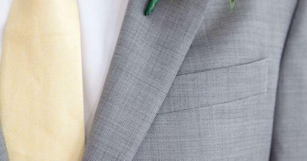 men's attire. gardenia boutonniere.