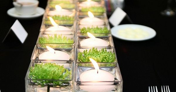 Simple centerpiece with big impact! Square glass vases with alternating floating candles