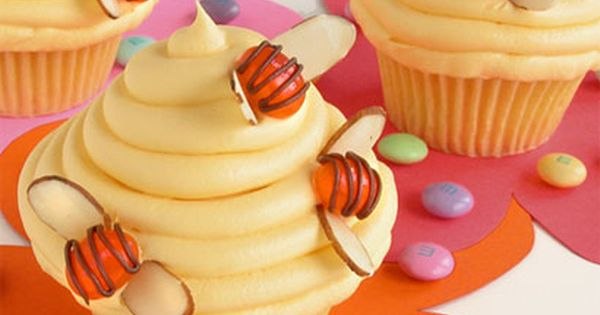 "Jelly Bean ""Bees"" with sliced almond wings on Beehive cupcake."