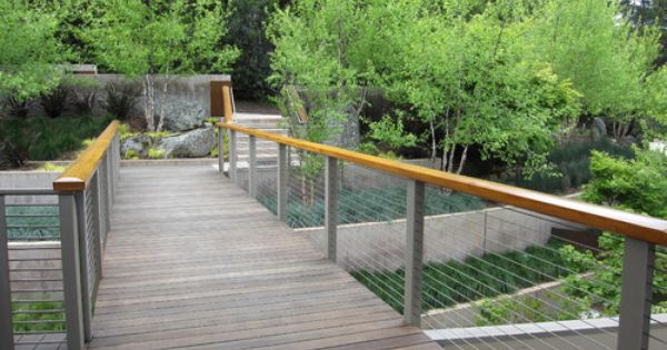 Wrought Aluminum Posts Ground And Pace The Railing Design Metal Wire Helps To Disappear The Structur Modern Landscaping Concrete Retaining Walls Patio Railing