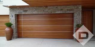 Image Result For Garage Doors With Timber Cladding Contemporary Garage Doors Garage Doors Modern Garage Doors