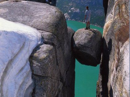 Kjeragbolten, a 5 m³ boulder wedged in a mountain crevasse by the