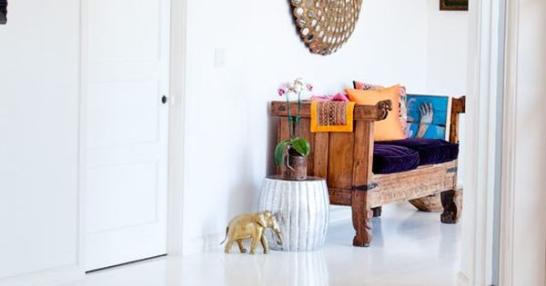 boho interior. colorful patterned rug in an all white interior. via Hippie