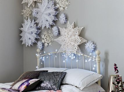 You can create oversized paper snowflakes for a winter wonderland feel: