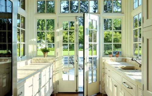 Love the natural light in this greenhouse kitchen.