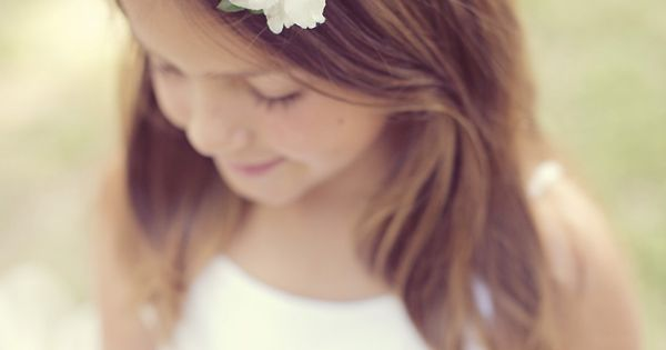 Bohemian flower girl with pretty, delicate wreath.